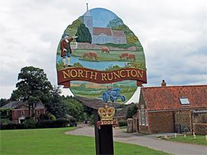 The colourful village sign