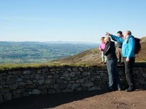 Family looking out from Moel Famau Bwlch Pen Baras