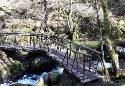 Alpine Bridge over river in Hafod