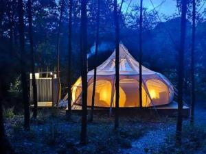 Eithinog Hall glamping at dusk