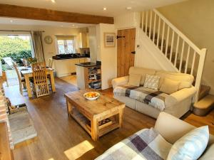 Open plan living dining space in Coopers Cottage