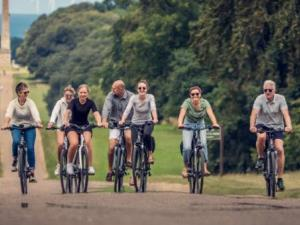 Riding e-bikes through Holkham Estate