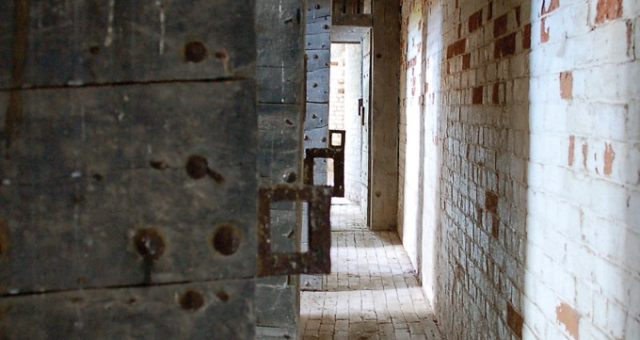 Corridor with cell doors at Walsingham Bridewell