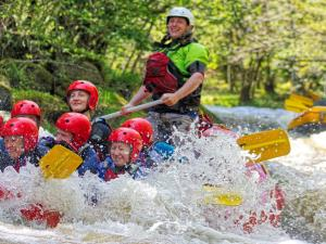 Rafting the Graveyard rapid on the Afon Tryweryn