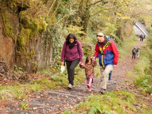 Family walking up the Allt Wylly incline.