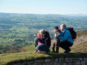 Family looking out from Moel Famau