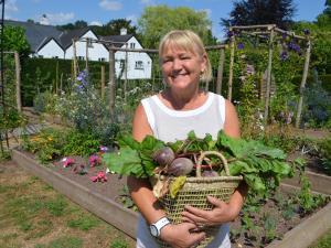 Owner Sarah Hudson in the kitchen garden