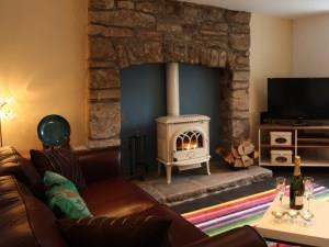 Enjoy champagne in front of our woodburner