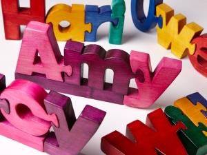 Handmade wooden name jigsaws by Tawny Owl Toys