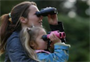 Mother and daughter using 'puffin' binoculars
