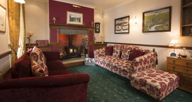 Guest Lounge with Cosy Wood Burner
