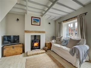 Comfortable seating, cosy woodburner - perfect for
