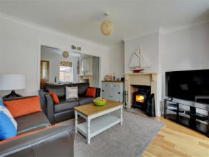 Open plan living room with comfortable seating, TV