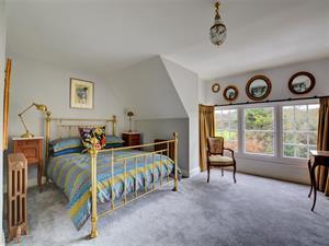 Spacious master bedroom with king size bed,