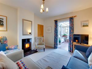 Sitting Room with woodburner and comfortable seati